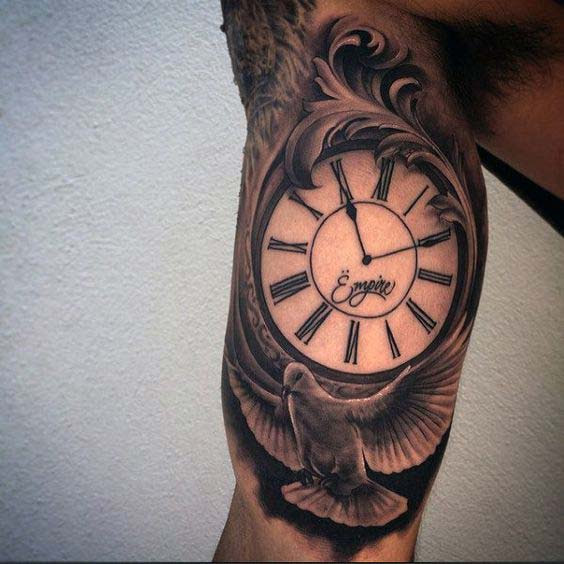 clock and dove inner bicep tattoo for men