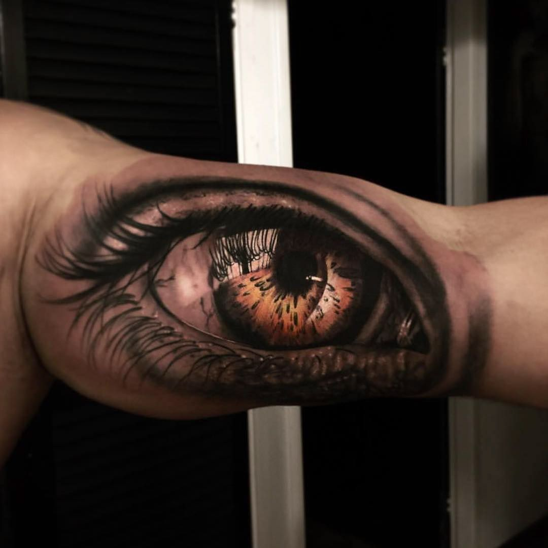colored eye inner bicep tattoo for men