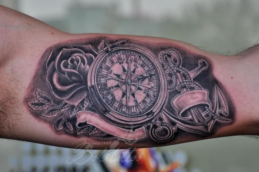 detailed rose, anchor, and compass tattoo for guys