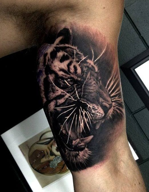 detailed tiger face inner bicep tattoo for men