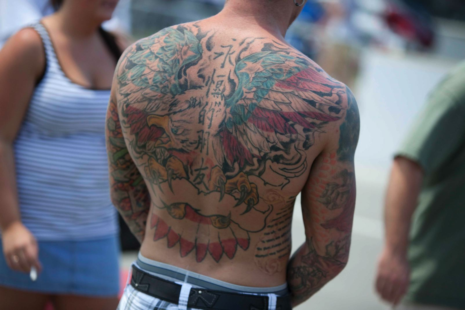 feathered wings back tattoo for men