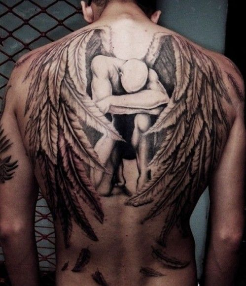 kneeling angel back tattoo for men