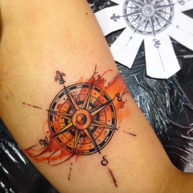 orange accent compass tattoo for men