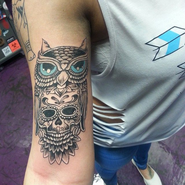 owl and skull inner bicep tattoo for men