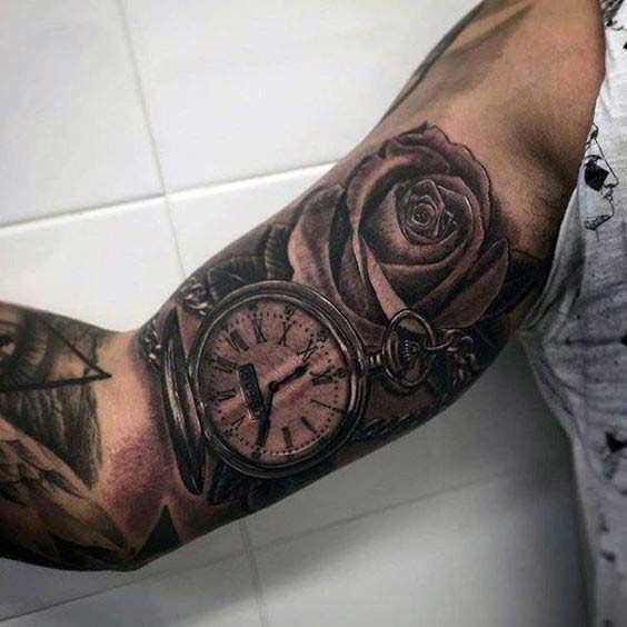 pocket watch and rose inner bicep tattoo for men