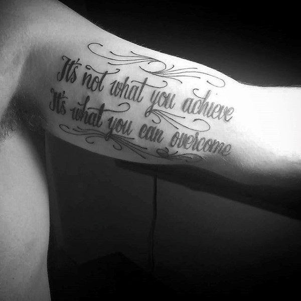 saying inner bicep tattoo for men