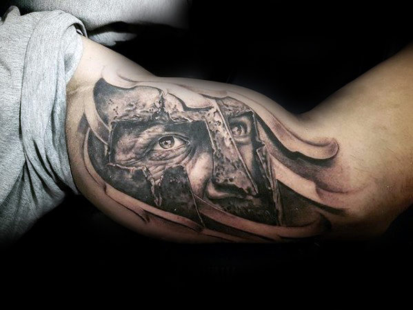warrior face inner bicep tattoo for men