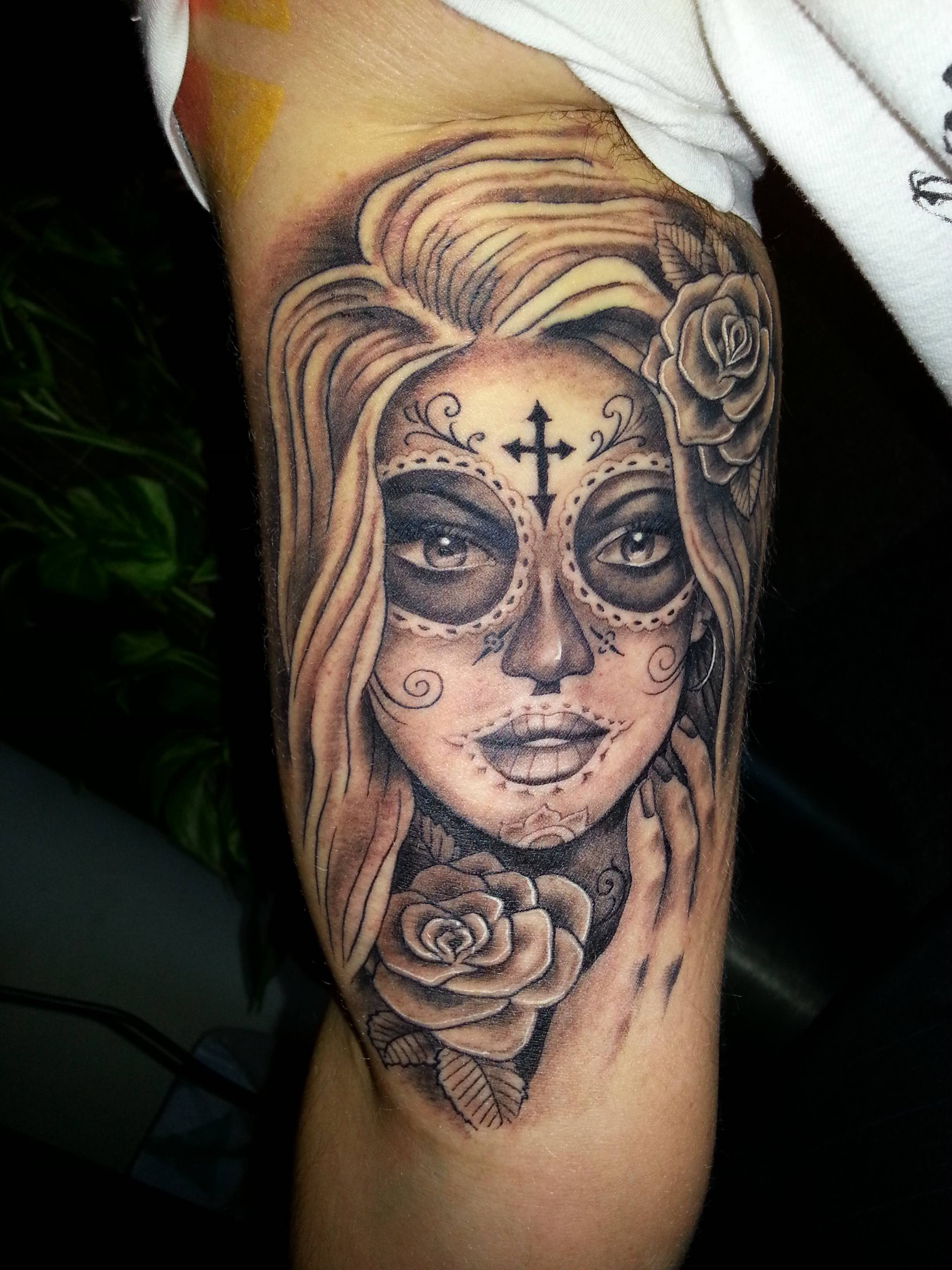 woman's death face inner bicep tattoo for men