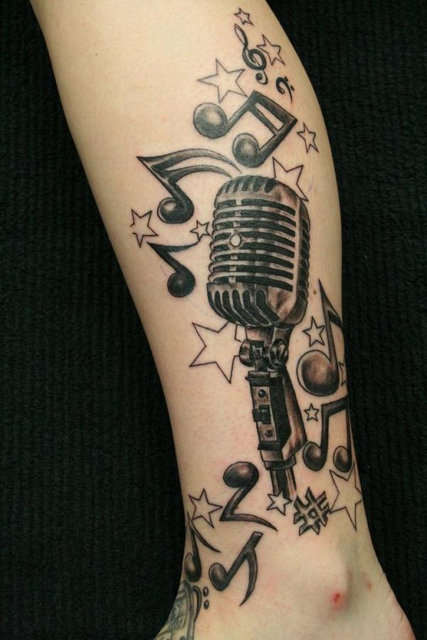 microphone leg tattoo for men