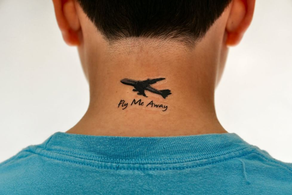 airplane neck tattoo for men