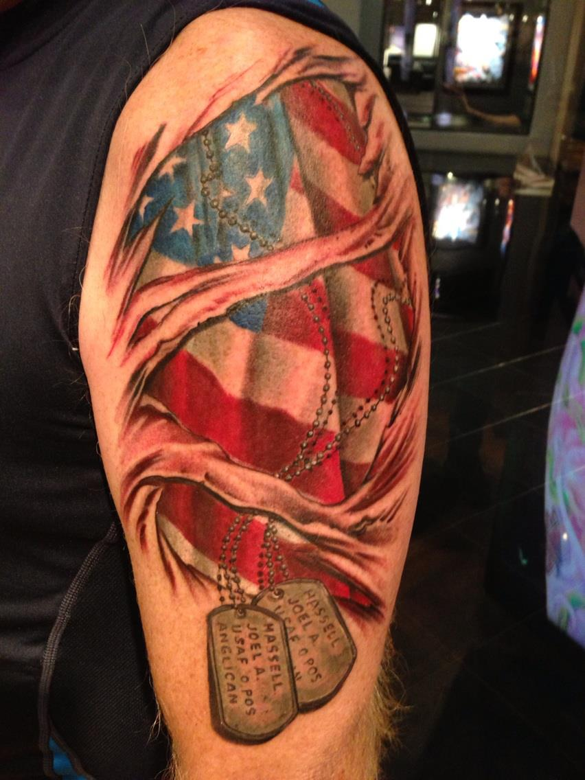 dog tags hanging from american flag tattoo for men