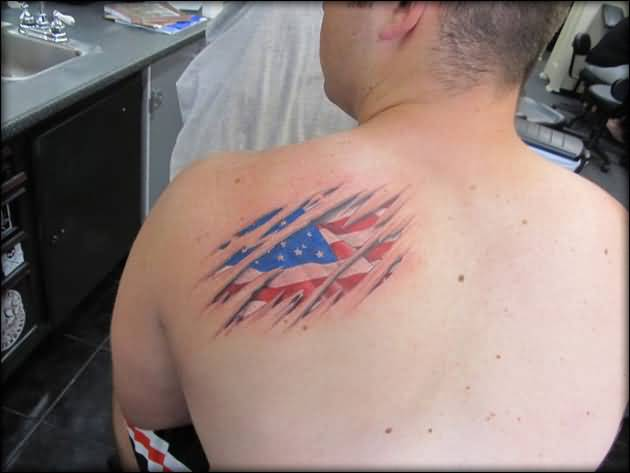 torn back american flag tattoo for men