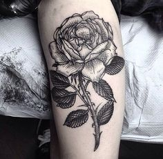 roses on arm tattoo