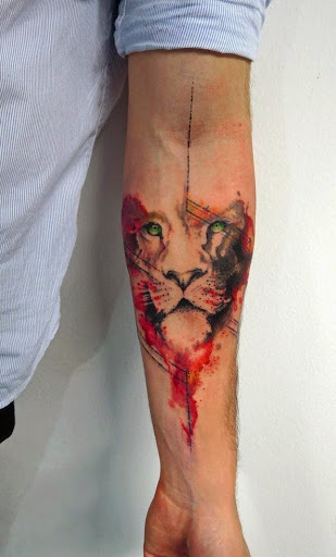 Small-Watercolor-Lion-Tattoo-On-Forearm-1