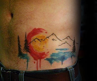 mens-hip-ribs-colorado-watercolor-tattoos