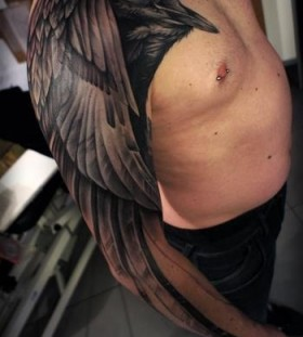 aweseome chest and arm wing tattoo for men