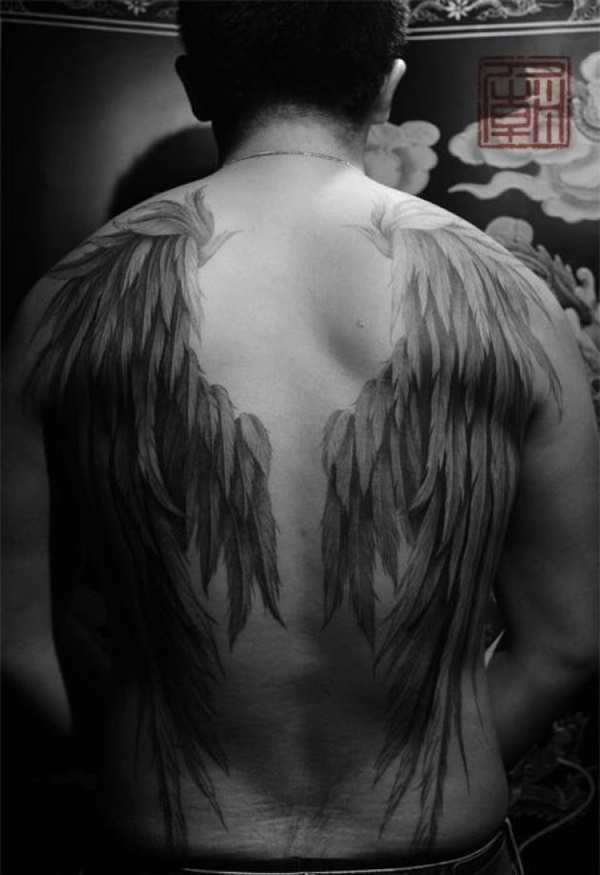 detailed wing tattoo for men's backs