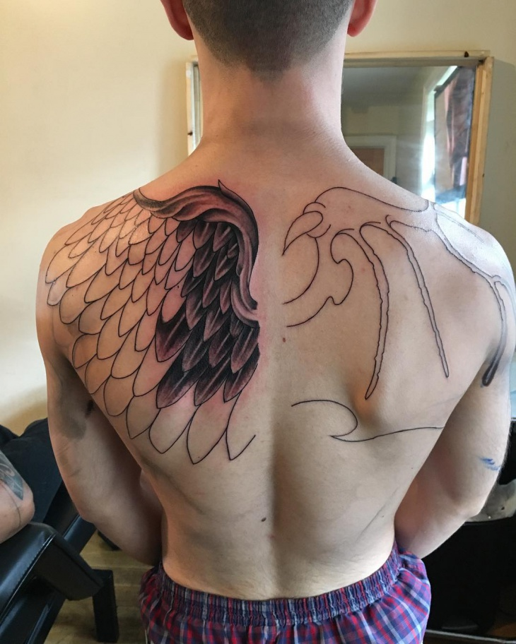 feather and dragon wings tattoo for men