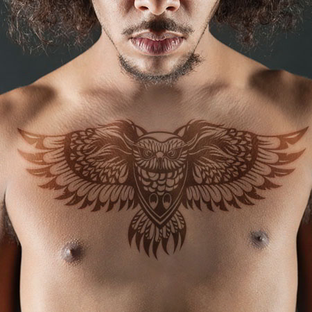 flying owl men's chest tattoo