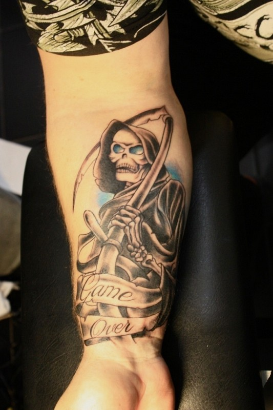 game over forearm grim reaper tattoo for men