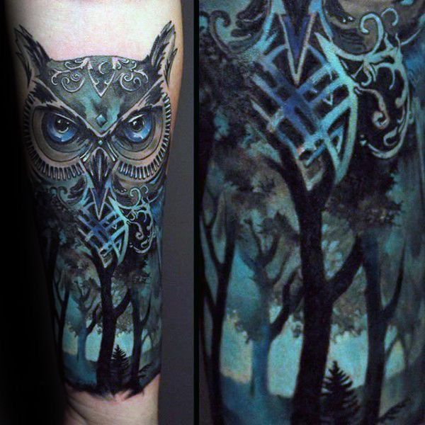 owl face above forest tattoo for men's inner arms