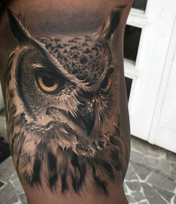 realistic men's owl tattoo on calf