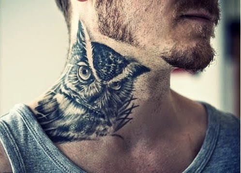 realistic owl tattoo on man's neck