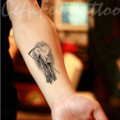 small grim reaper tattoo for men wrist