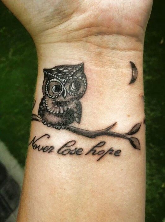 small owl tattoo for men's wrists