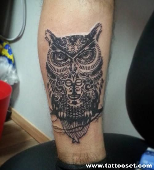 totem owl on branch men's inner arm tattoo
