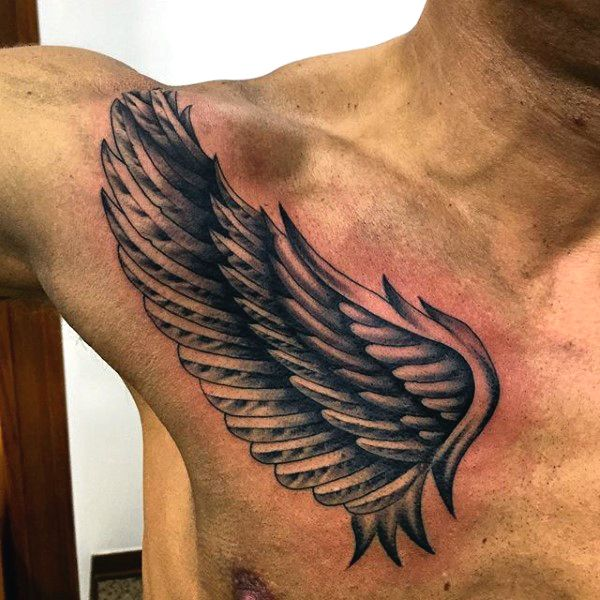 upper chest wings tattoo for men