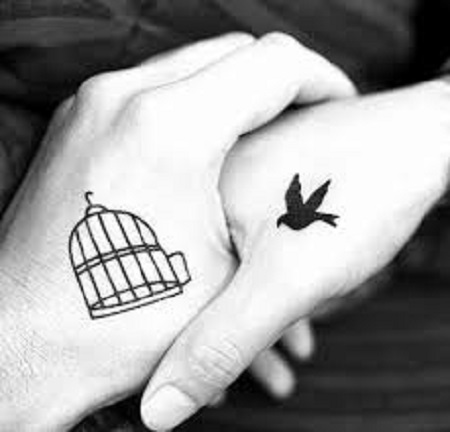 bird and cage matching couple tattoo