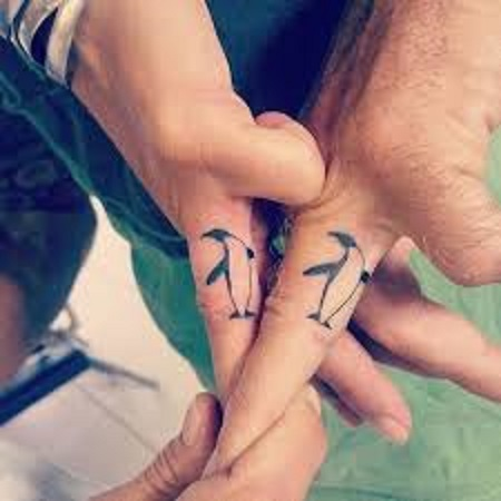 penguins matching couple tattoo