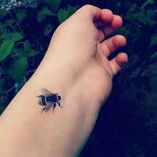 small insect tattoo for men