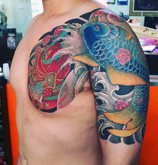 Koi Fish Shoulder and Chest Tattoo