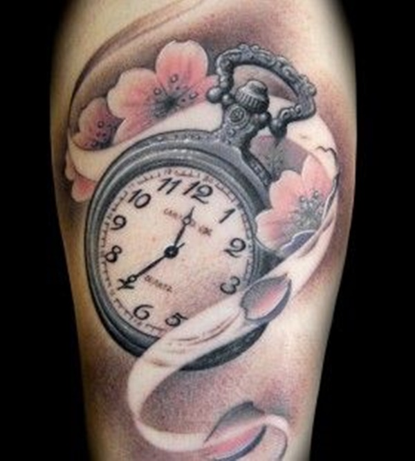 Personal Clock Tattoo Surrounded by a Floral Design