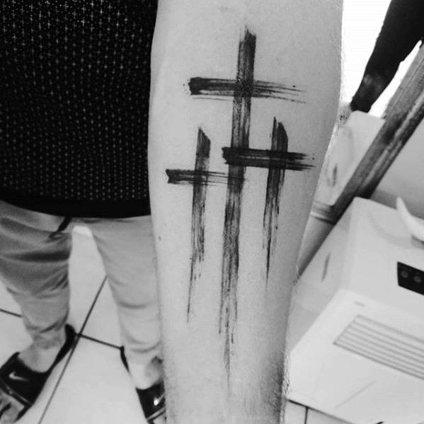 Forearm Tattoo of the Three Crosses on Calvary Hill
