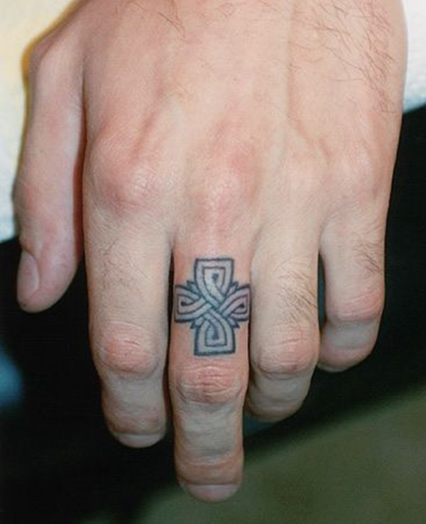 Roman Catholic Cross Finger Tattoo